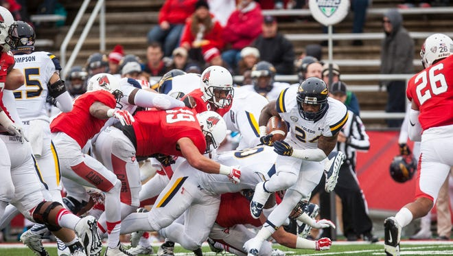 Toledo's running back Damion Jones-Moore breaks through Ball State's defensive line Saturday during Ball State's homecoming game. Ball State lost 24-10.