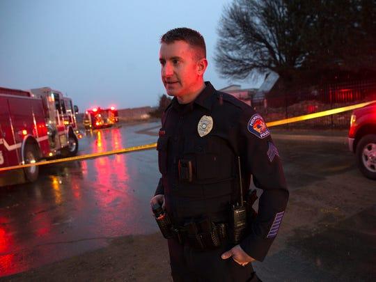 Farmington Police Department Sgt. Guy Postlewait provides information about a fatal car crash Thursday in Farmington.