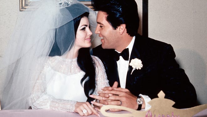 Singer Elvis Presley and his bride, the former Priscilla Beaulieu, gaze into each other's eyes after their wedding on May 1, 1967.