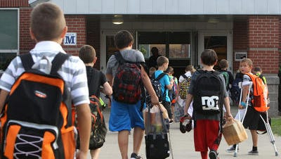 Students arrive at the first day of classes at Silver Creek Elementary on July 29, 2015.