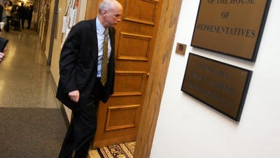 Lobbyist Bo Johnson heads into a House legislative office in 2008. Johnson has done work for investment groups Enhanced Capital and Stonehenge Capital