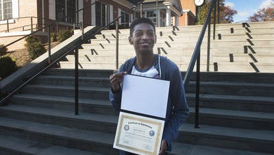 Moorestown Friends student Calvin Bell III stands on the steps at his school recently. Bell was one of 20 young innovators to visit the White House and U.S. Capitol Building in November through the ESA Leaders on the Fast Track Video Game Innovation Fellowship.