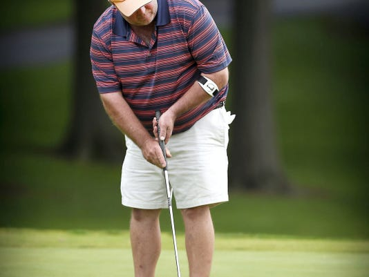 Tim Leeper lines up a putt during the first round of play at the Lebanon County Amateur on Saturday morning at Lebanon Valley Golf Course. Leeper shot a 69 and is three shots behind the leader, John DiGiacomo.