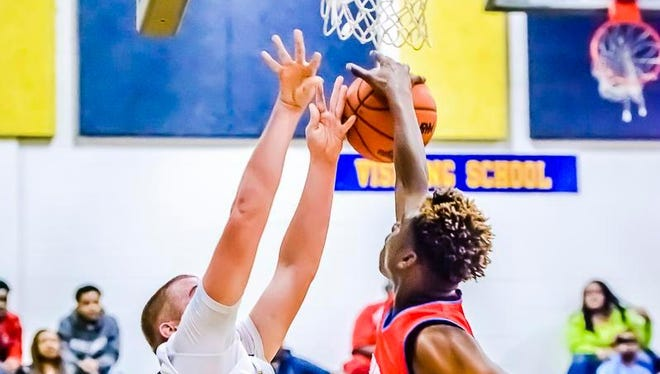 Marquez Gordon ,right, of Everett blocks a shot attempt by Jordon Goebel of Grand Ledge during their game Friday in Grand Ledge.
