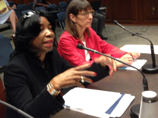 Rep. Barbara Norton (left), D-Shreveport, explains her House Bill 87 on equal pay for women to the House Labor and Industrial Relations Committee, which killed the bill. Listening at right is Julie Schwam Harris of New Orleans, co-chair of the Legislative Agenda for Women.