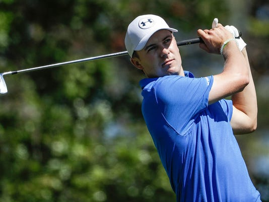 Jordan Spieth hits on the fourth tee during the final round of the Masters golf tournament Sunday, April 9, 2017, in Augusta, Ga. (AP Photo/David Goldman)