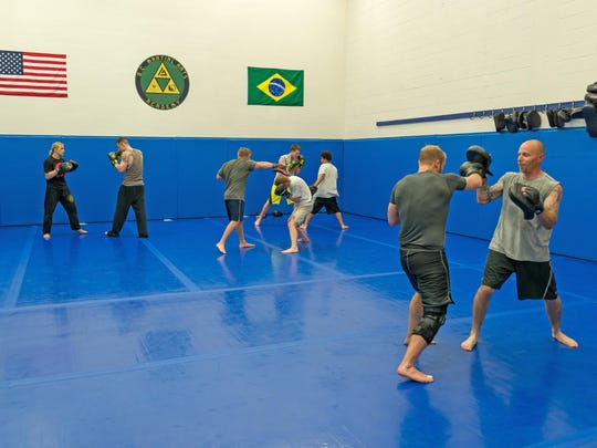 Students in the adult Brazilian jiu-jitsu class spar at B.C. Martial Arts Academy.