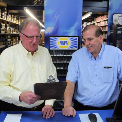John Baehr, NAPA Auto Parts Distribution Center general manager, and Scott Furgason, Central WI Auto Parts owner, discuss the results of the In A Fix program that helps income-eligible, working resident of Portage County with car repairs so they can get to work.