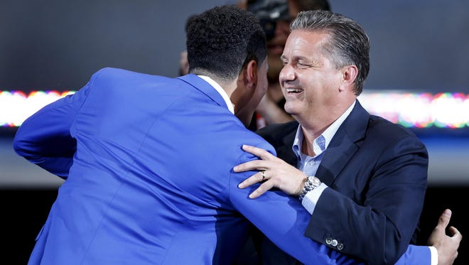 Kentucky coach John Calipari congratulates Devin Booker after Booker was drafted 13th overall by the Phoenix Suns.