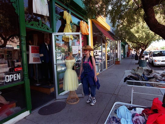 A shopper browses on North Fourth Avenue in Tucson.