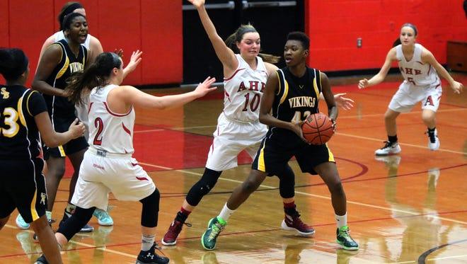 South Brunswick high school at Bishop Ahr girls basketball Saturday February 6, 2016 South Brunswick #42 Leahanna  Hunter tries to pass around Bishop Ahr #10 Sara Decker.  photo by Ed Pagliarini