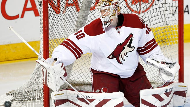 Arizona Coyotes goaltender Devan Dubnyk (40) makes a save during warmup before his start against the Edmonton Oilers at Rexall Place on Dec. 23 in Edmonton, Alberta.