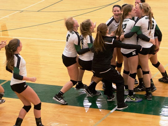 Novi players celebrate after winning their fifth straight