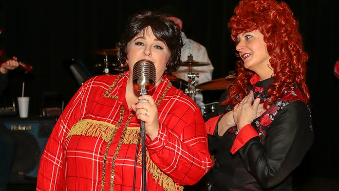 """Mary Jo Bell, left, as Patsy Cline and Jenifer Thomas as Louise Segar prepare for the Hartland Players' upcoming performance of """"Always... Patsy Cline.""""Local actors and musicians are bringing the music and story of the late country legend Patsy Cline to life!""""Always… Patsy Cline"""" is based on the true story of the friendship between Patsy Cline (Mary Jo Bell) and her biggest fan and best friend Louise Seger (Jenifer Thomas).  After hearing her perform """"Walkin' After Midnight"""" on the """"Arthur Godfrey Show"""" in 1957, Louise quickly becomes Patsy Cline's biggest fan!  Years later and after hounding the local disc jockey to play Patsy Cline's records every day, Louise finally meets Patsy and the two form a quick and strong friendship that lasted until her death in a plane crash in 1963.  Backed by the Bodacious Bobcats, Patsy Cline performs 27 of her most famous songs while Louise Seger tells stories of the time they spent together and the letters they shared. Four performances of """"Always… Patsy Cline"""" will be held April 22nd, 28th, & 29th at 8 pm and April 23rd at 2 pm.  Performances will be at the Hartland Music Hall 3619 Avon St (Hartland Rd), Hartland, MI.Tickets are $14 for adults and $12 for students and seniors and are available online at hartlandplayers.org, at the Main Branch of the Cromaine Library, and at the door 30 minutes before the show. For more information call (810) 632-5849.Band members include: Randy Bell, bass; Pete Bullard, lead guitar; Savannah Lee, piano; Frank Moser, rhythm guitar; John Pollizer, fiddle; Harry Rodman, drums."""