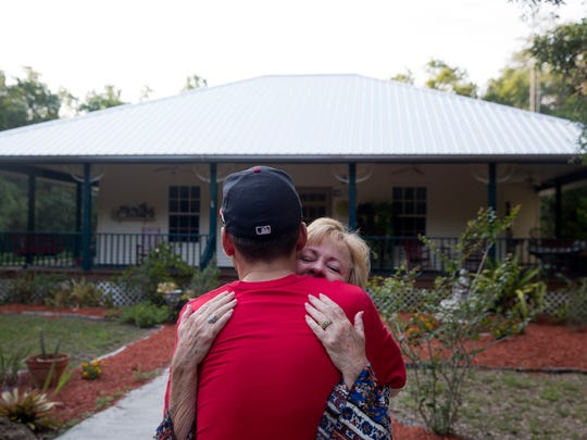 Brice Foutch gives his mother Debbie Foutch a hug as goodbyes are shared at his childhood home on the outskirts of Labelle, Fla. Tuesday, May 3, 2016.