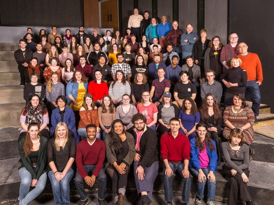 University of Wisconsin-Milwaukee theater students, faculty and staff pose during the reconstruction of the Mainstage Theatre, which was gutted in a fire in 2017.