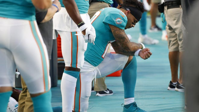 Dolphins receiver Kenny Stills kneels during the national anthem before the game vs. the Atlanta Falcons.