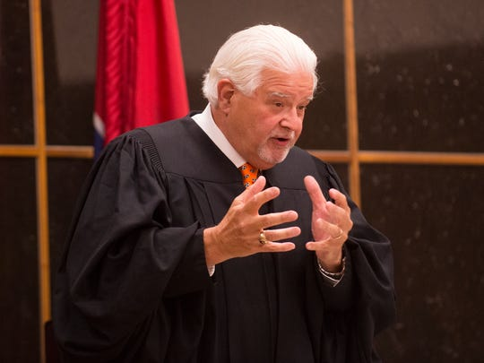 Senior Judge Paul Summers addresses the court during a sentencing hearing.
