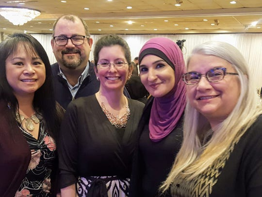 "Shown with American activist and Women's March Co-Founder Linda Sarsour (second from right) are (from left) ATNJ members Uyen ""Winn"" Khuong, Scott Baron, Johannah Hinksmon and Kim Baron."