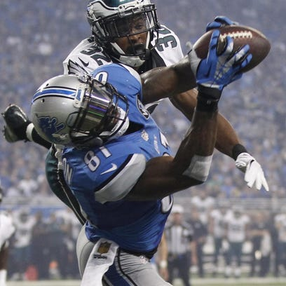 Lions wide receiver Calvin Johnson snags one of his