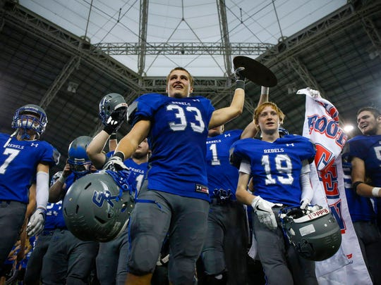 Members of the Gladbrook-Reinbeck football team celebrate a state win over Algona Bishop Garrigan on Thursday, Nov. 17, 2016, during the 2016 Iowa high school Iowa Class A football championships at the UNI-Dome in Cedar Falls.