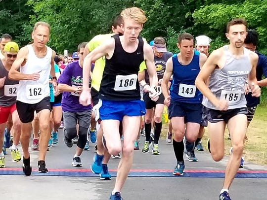 The 8K runners get off to a fast start in the 2018 Northville Road Runners Classic at Maybury State Park.