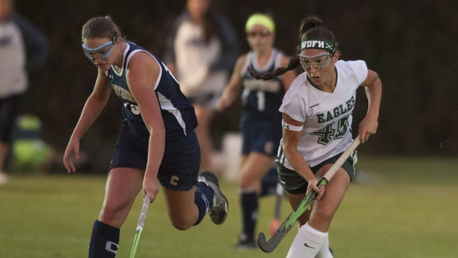 West Deptford's Trisha Baud, right, battles Collingwood's Dominique Hunt during a game from last year. Baud is expected to provide leadership for the Eagles this fall.