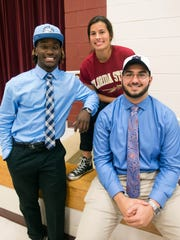 Nick Brahms, right, joined Navarre High School star athletes Michael Carter and Emily Madril in leaving high school early to continue their athletic careers at Division 1 colleges in January.