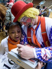 Rodeo clown Trent McFarland entertain children and their families during the Miracle Rodeo at Garrett Coliseum in Montgomery, Ala., on Wednesday March 15, 2017. The SLE Rodeo will be held from Thursday the 16th to Saturday the 18th.