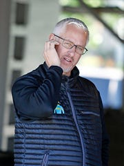 Trainer Todd Pletcher watches activities outside his barn at Churchill Downs in Louisville, Ky., Monday, May 1, 2017.