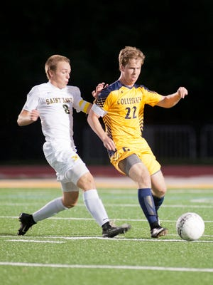 Collegiate midfielder Henry Stites keeps the ball away from St. X. defender Michael Hagerty in the KHSAA 26th district boys soccer championship. 12 October 2017