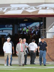 Alabama head football coach Nick Saban walks onto the