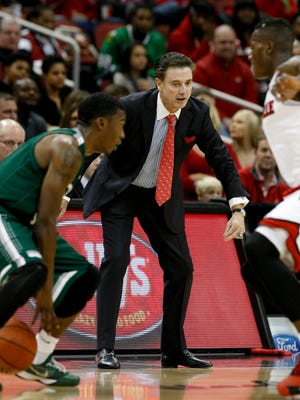 U of L head coach Rick Pitino watched his team play defense against Cleveland State during their game at the KFC Yum! Center.