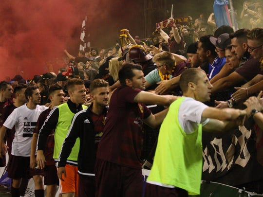 Detroit City FC players shake hands with members of the Northern Guard one final time after losing to Midland-Odessa FC, 1-0, following a penalty shootout in the National Premier Soccer League national semifinal Saturday, Aug. 5, 2017, at Keyworth Stadium in Hamtramck