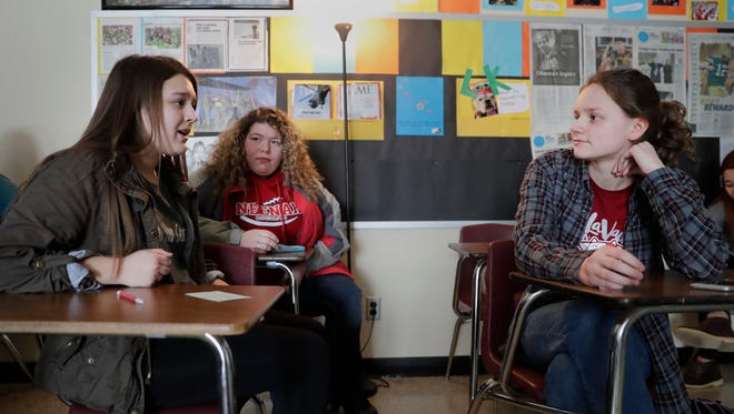 "Lydia Engelbreth, left, a senior at Neenah High School, discusses the movie ""Black or White"" with classmates Alexis Baumann and Aimee Roekle in their Race, Rights and Transcultural Beliefs class ."
