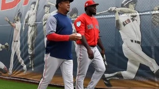 Red Sox relief pitcher Domingo Tapia (right) walks with Hall of Fame hurler Pedro Martinez last spring. Tapia was claimed off waivers by the Seattle Mariners on Friday.