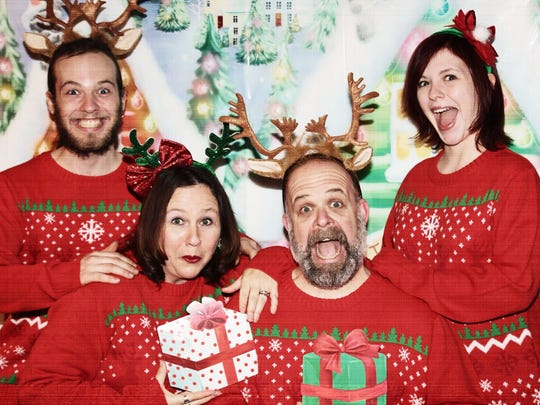 The McCammon family picked up matching ugly Christmas sweaters for their annual family photo.