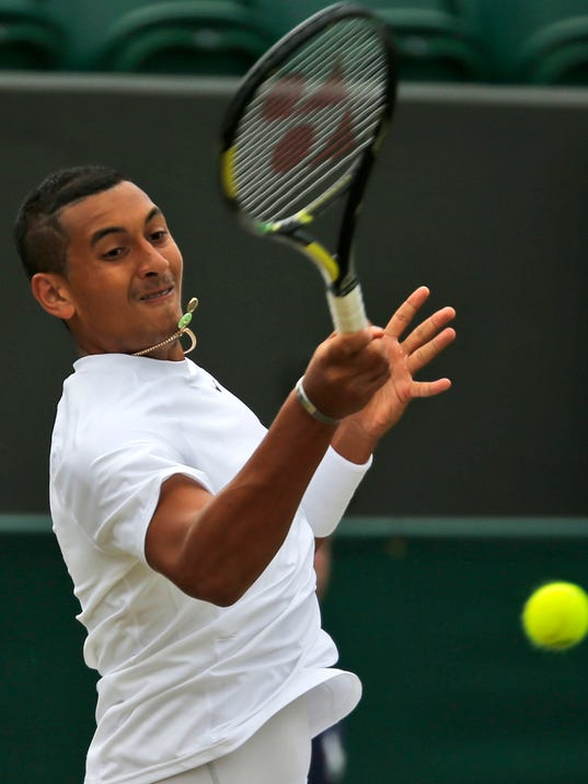Nick Kyrgios of Australia plays a return to Richard Gasquet of France during their match at the All England Lawn Tennis Championships in Wimbledon, London, Thursday, June 26, 2014. (AP Photo/Pavel Golovkin)