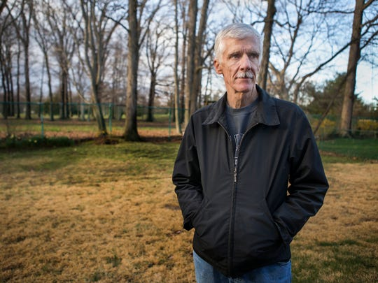 John Culin poses for a portrait in the back yard of his home, which sits adjacent to the former Brandywine Country Club golf course, in Brandywine Hundred on Thursday evening.