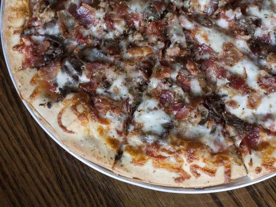 The Slaughterhouse Five — a five-meat pizza — is a favorite at Jockamo Upper Crust Pizza, 5646 E. Washington St.