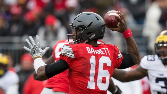 Nov 26, 2016: Ohio State Buckeyes quarterback J.T. Barrett (16) fires a pass upfield in the first quarter against the Michigan Wolverines at Ohio Stadium.