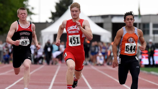 Lincoln's Collin Brison crosses the finish line to win the Class AA boys' 100 meter dash during the State Track and Field Meet on Saturday, May 27, 2017 at Howard Wood Field.