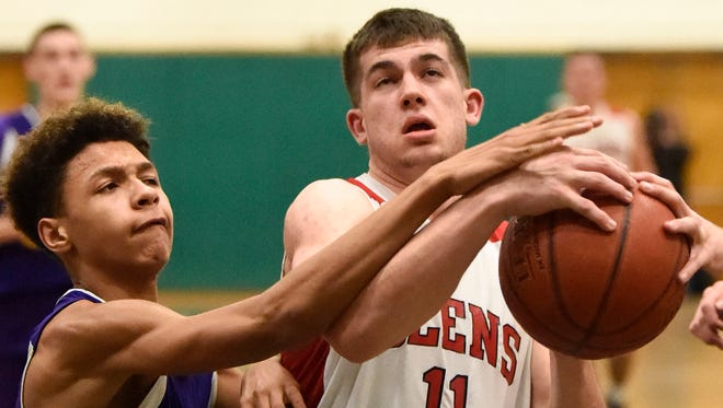 Joseph Girard III of Glens Falls is fouled by William Brown of Amsterdam at SUNY Adirondack in Queensbury Tuesday, February 14, 2017.