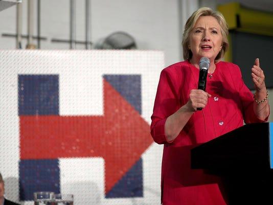 Hillary Clinton And Tim Kaine Take Campaign Bus Tour Through Pennsylvania And Ohio