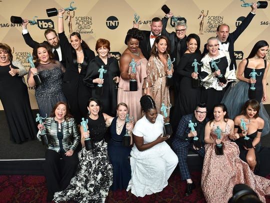 "The cast and crew of ""Orange is the New Black"" pose in the press room with their awards for outstanding performance by an ensemble in a comedy series at the 23rd annual Screen Actors Guild Awards at the Shrine Auditorium & Expo Hall on Sunday, Jan. 29,  in Los Angeles."