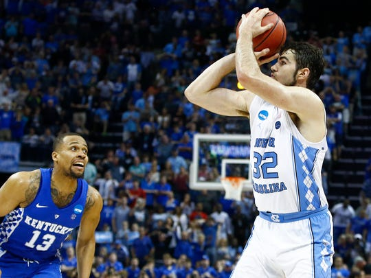 University of North Carolina forward Luke Maye (right) in front of University of Kentucky defender Isaiah Briscoe (left)  hitting the game winning shot with .3 seconds on the clock to win 75-73 to advance to next weeks NCAA tournament Final Four.