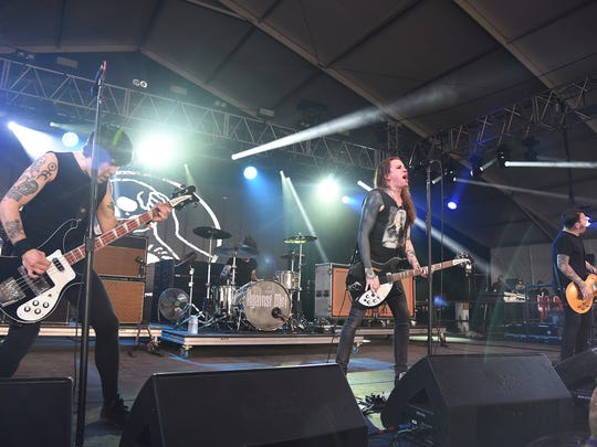 Against Me! performs  on stage during the 2015 Bonnaroo Music & Arts Festival. Against Me! is set to open for Green Day in Des Moines Monday night.