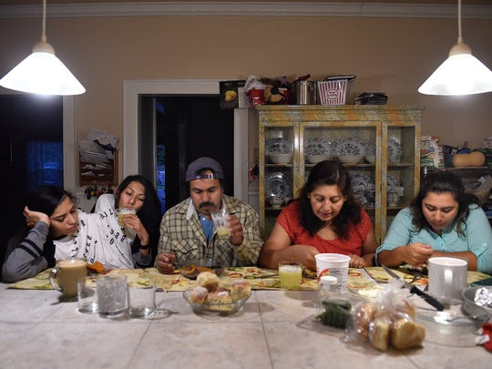 Conjoined twins Carmen and Lupita Andrade have dinner with their father, Victor, mom Norma and sister Abby, from left, in the kitchen at their New Milford home on Oct. 7, 2016. The family came to the United States for medical care for the twins when they were babies. The twins have ongoing medical issues, including severe scoliosis.