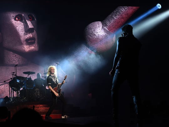 Guitarist Brian May (L) and singer Adam Lambert perform