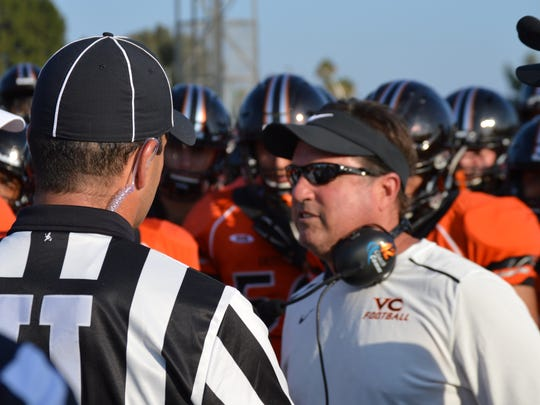 Ventura College head coach Steve Mooshagian speaks to officials during the Pirates' scrimmage at Los Angeles Valley on Aug. 24 in Van Nuys.